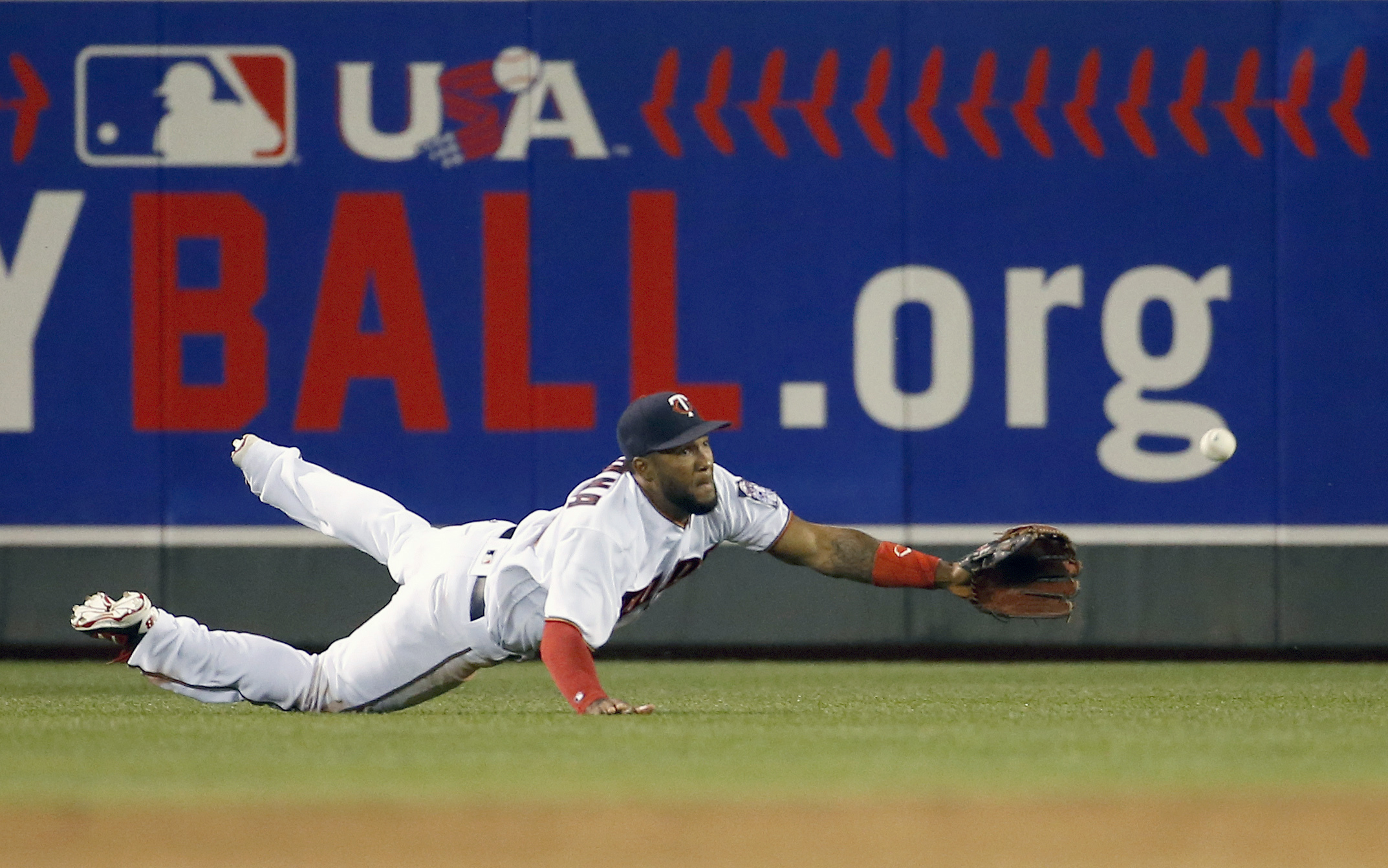 Minnesota Twins Center Fielder Danny Santana Dives To Catch A Fly To Right By Kansas City Royals' Omar Infante During The Fourth Inning Of A Baseball Game In Minneapolis, Monday, May 23, 2016. The Royals Won 10-4. (AP Photo/Ann Heisenfelt)